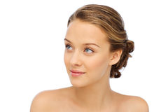 Smiling young woman face and shoulders Stock Image