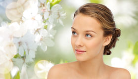 Smiling young woman face and shoulders Royalty Free Stock Photos