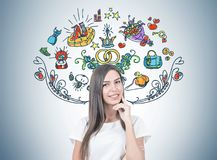 Positive young woman portrait, marriage. Smiling young woman with fair hair wearing a white T shirt and thinking while looking at the viewer. Colorful marriage Stock Photos
