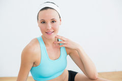 Smiling young woman with at fitness studio Stock Images