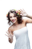 Smiling young woman with flower in hair Stock Photos