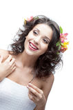 Smiling young woman with flower in hair Royalty Free Stock Photo