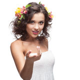 Smiling young woman with flower in hair Royalty Free Stock Images