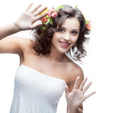 Smiling young woman with flower in hair Royalty Free Stock Photos