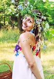 Smiling young woman in flower  wreath Stock Images