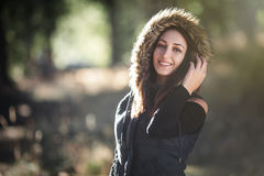 Smiling young woman in the forest Royalty Free Stock Photography