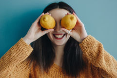 Smiling young woman with fresh lemon on eyes Royalty Free Stock Photo