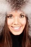 Smiling young woman in fur hat Royalty Free Stock Images