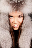 Smiling young woman in fur hat Royalty Free Stock Photo