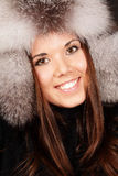 Smiling young woman in fur hat Royalty Free Stock Photos