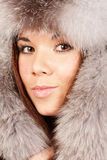 Smiling young woman in fur hat Stock Photos