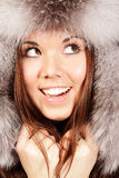 Smiling young woman in fur hat Stock Photography