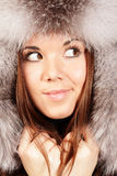 Smiling young woman in fur hat Royalty Free Stock Image