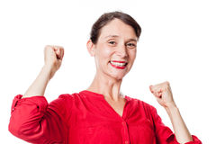 Smiling young woman gesturing and expressing fun victory Stock Image