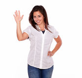 Smiling young woman gesturing a greeting with hand Royalty Free Stock Photos