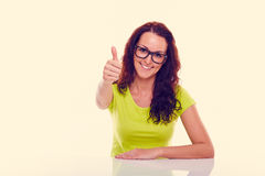 Smiling young woman gesturing thumb up. Toned royalty free stock photography