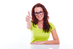 Smiling young woman gesturing thumb up Stock Photo