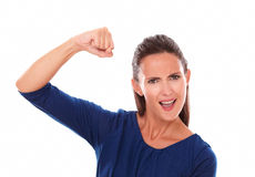 Smiling young woman gesturing a victory Royalty Free Stock Image