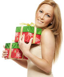 Smiling young woman with gift Royalty Free Stock Photo