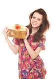 Smiling young woman with gift gold box as heart Royalty Free Stock Images