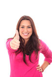 Smiling young woman giving thumbs up Stock Image