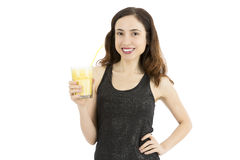 Smiling young woman with a glass of banana smoothie Royalty Free Stock Image