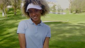 Smiling young woman golfer on a golf course stock footage