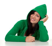 Smiling young woman in green hood Royalty Free Stock Image