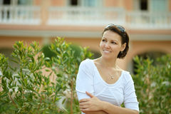 Smiling young woman in green park. Stock Photo