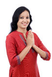 Smiling young woman greeting Namasthe Royalty Free Stock Photo