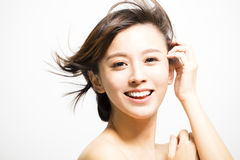 Smiling  young Woman with hair motion Royalty Free Stock Photos
