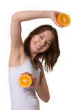 Smiling young woman with halfs of orange. Royalty Free Stock Photos