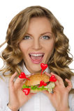 Smiling young woman with hamburger from hearts Stock Image