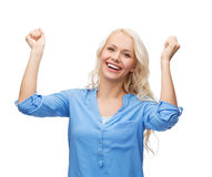 Smiling young woman with hands up Stock Photos