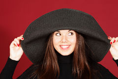 Smiling young woman in hat Royalty Free Stock Photography