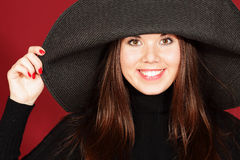 Smiling young woman in hat Royalty Free Stock Photos