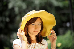 Smiling young woman in a hat Stock Images