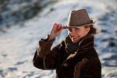 Smiling young woman with hat. Beautiful young woman in a park in winter time stock photo