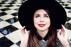 Smiling Young Woman in a Hat Royalty Free Stock Images