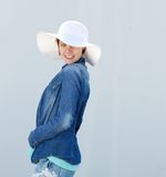 Smiling young woman with hat Royalty Free Stock Images