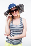 Smiling young woman in hat and sunglasses Royalty Free Stock Images