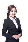 Smiling young woman with headphone. Smiling business woman with headphone isolated white background, asian royalty free stock image