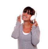 Smiling young woman with headphone listening music Royalty Free Stock Photography