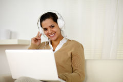Smiling young woman with headphone looking at you Stock Photography