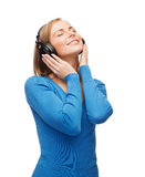 Smiling young woman with headphones Stock Photos