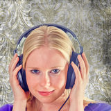 Smiling young woman with Headphones Royalty Free Stock Photo