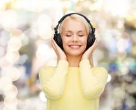 Smiling young woman with headphones Stock Photo