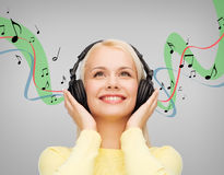 Smiling young woman with headphones Royalty Free Stock Photography