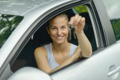 Smiling Young Woman in her Car Holding Keys Stock Image