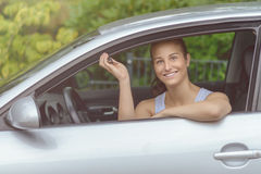 Smiling Young Woman in her Car Holding Keys Stock Photo